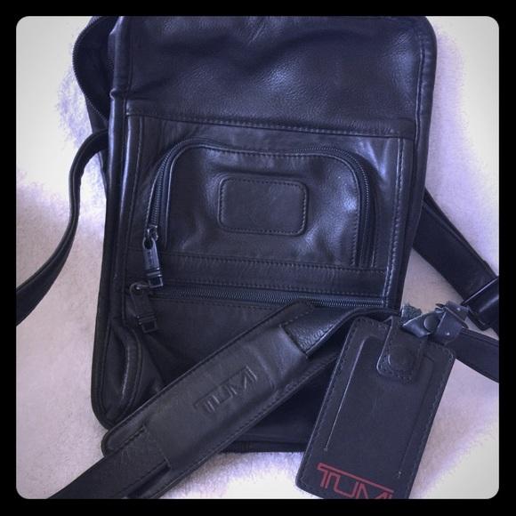 38015c4696 Tumi crossbody bag